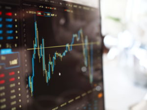 Monitor of financial advisor with stock market data pulled up.